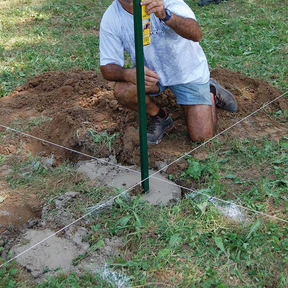 Posa dei pali nel terreno