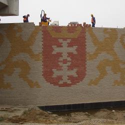 Muri a blocchi rinforzati con geogriglie Sistema Tenax T-Block